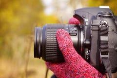 Camera in hand Stock Photos