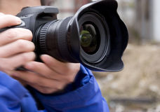 Camera in hand Stock Images
