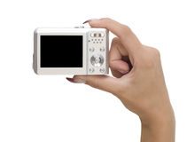Camera in a hand Stock Image