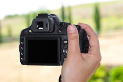 Camera in hand with black screen Royalty Free Stock Photo