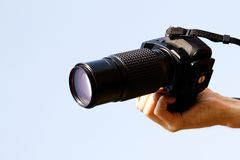 Camera  hand  optical Stock Photography