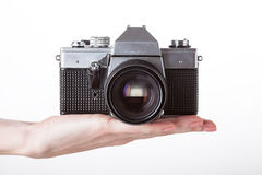 Camera and hand Royalty Free Stock Images