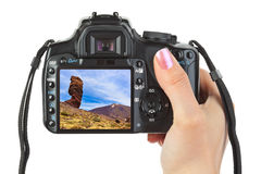 Camera in hand and Tenerife Canary view (my photo) Royalty Free Stock Photos