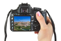 Camera in hand and Toledo Spain view  Stock Photo