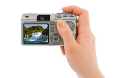 Camera in hand and waterfall (my photo) Stock Photography