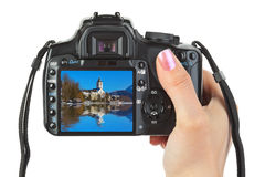 Camera in hand and winter Austria view Royalty Free Stock Photography