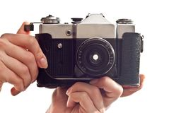 Camera in hands Royalty Free Stock Image
