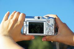 Camera in  hands Stock Images
