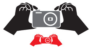 Camera in hands icon Royalty Free Stock Image