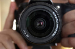 Camera in hands of the photographer. Royalty Free Stock Images