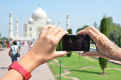 Camera in the hands pointing toTaj Mahal Royalty Free Stock Photo