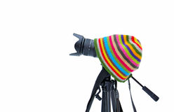 Camera in his hat. Camera on a tripod and a hat on a white background royalty free stock photo