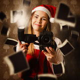 Camera holding santa helper taking christmas photo Royalty Free Stock Photo