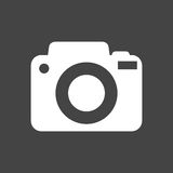 Camera icon on black background. Flat vector illustration Stock Image