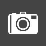 Camera icon on black background. Flat vector illustration. Stock Images
