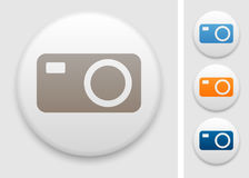 Camera icon. Camera symbol on round button Stock Images
