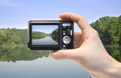 Camera In Hand Royalty Free Stock Photos