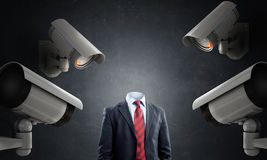 Camera keep an eye on man . Mixed media Stock Images