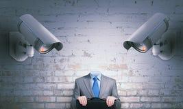 Camera keep an eye on man . Mixed media Stock Image