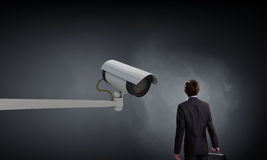 Camera keep an eye on man . Mixed media Stock Photo