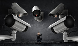 Camera keep an eye on woman . Mixed media Stock Image