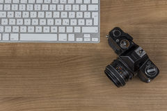 Camera keyboard on a desktop Royalty Free Stock Images
