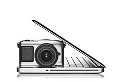 Camera and laptop Stock Image
