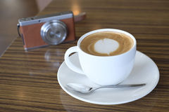 Camera and latte. Cafe latte and digital camera on table Stock Photography