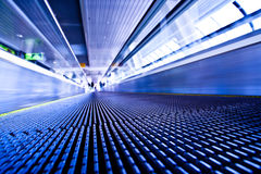 Camera lay on escalator view in violet corridor Royalty Free Stock Photo