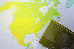 Camera lay on north america map. With yellow light stock image
