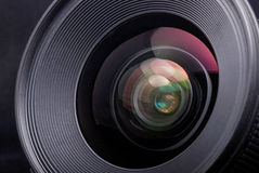 A camera lens. On the background Royalty Free Stock Photos