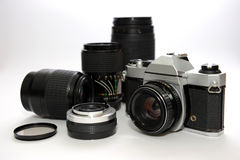 Camera And Lens. Camera And Equipment on plain background Royalty Free Stock Photo