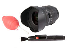 Camera lens. Lens cleaning untesils over a white background Stock Image