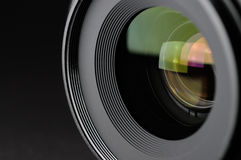 Camera lens. Close-up on black background Royalty Free Stock Photos