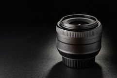 Camera lens. Close-up on black background Stock Images