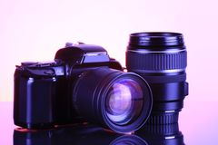 Camera and lens. Close-up of a camera and lens royalty free stock images
