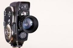 Camera and lens. 8mm old cinema camera on white background Royalty Free Stock Image