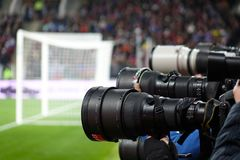 The camera lens on the background of a football field. The football world Cup Royalty Free Stock Photos
