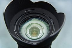 Camera lens with a blend close-up on. A light background Royalty Free Stock Images