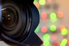 Camera Lens with bokeh Background. Professional Camera Lens with bokeh Christmas lights background Stock Photos