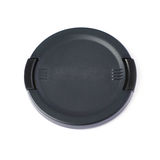 Camera lens cap isolated over white background Royalty Free Stock Photo