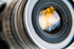 Camera lens. Capturing nature colors royalty free stock photo