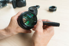 Camera lens cleaning with special brush, close-up Royalty Free Stock Photography