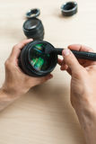 Camera lens cleaning with special brush, close-up Stock Photo
