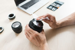 Camera lens cleaning with wet wipe, close-up Stock Photo