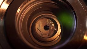 Camera lens close-up. Aperture focusing macro zoom lens stock video footage
