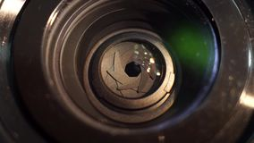 Camera lens close-up. Aperture focusing macro zoom lens stock video