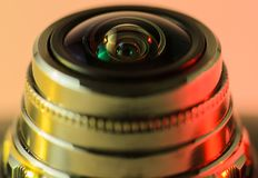 Camera lens close - up backlit yellow-red. Horizontal photo. Camera lens close - up and beautiful backlit yellow-red. Horizontal photo stock photos