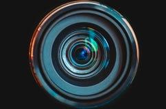 Camera lens close up on black background. Camera lens with colorful reflections close up on black background Stock Photos