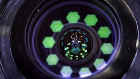 Camera lens close-up. Aperture focusing macro zoom lens stock footage